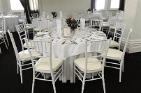 white tiffany chairs and table setup
