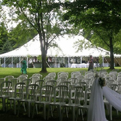 peg and pole tents with white chairs