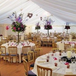 tiffany chairs and table inside draping decor